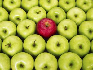 Contrast: The green apples make the red apple stand out.